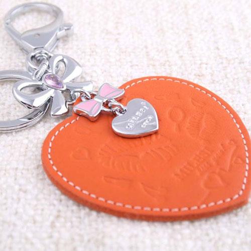 ★魔法Baby★心形皮雕蝴蝶結裝飾鋯石鑰匙釦(橘色)~流行精品,飾品~m0045
